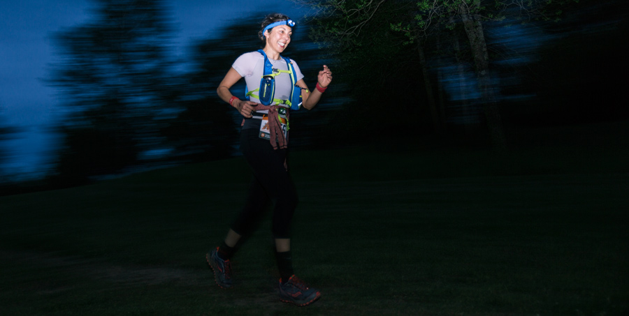a ragnar trail running relay participant running at night