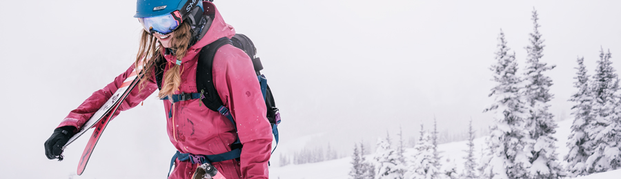 a skier wearing a hydration pack