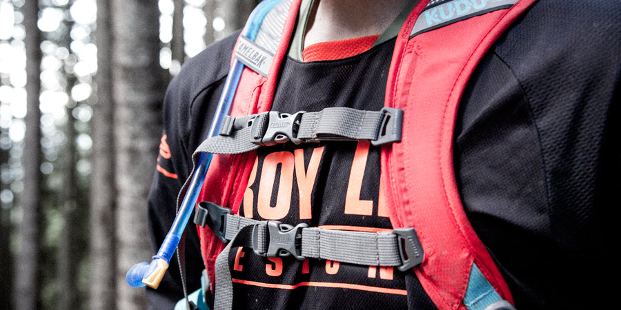 the shoulder and sternum straps of a hydration pack