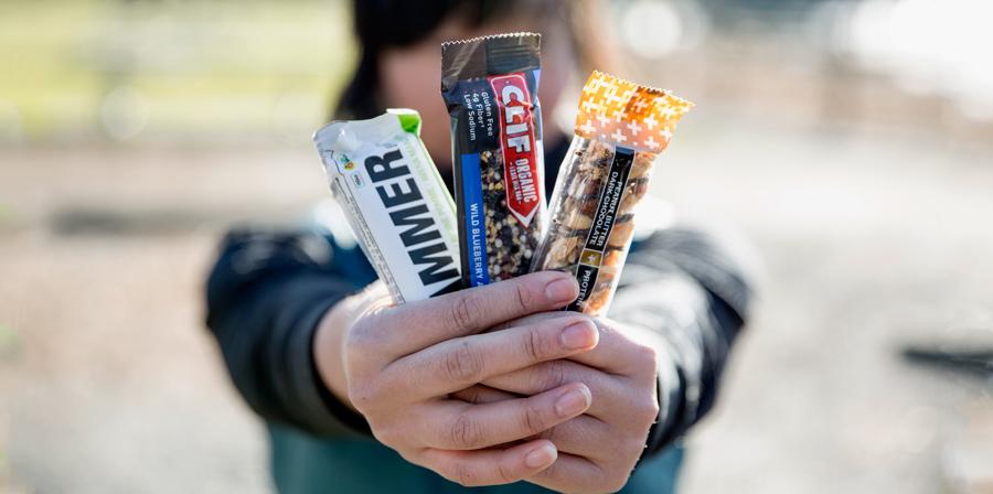 a trail runner displaying three edible bar options
