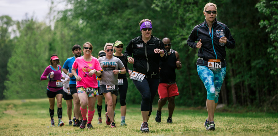 a cluster of trail runners at a trail running race event