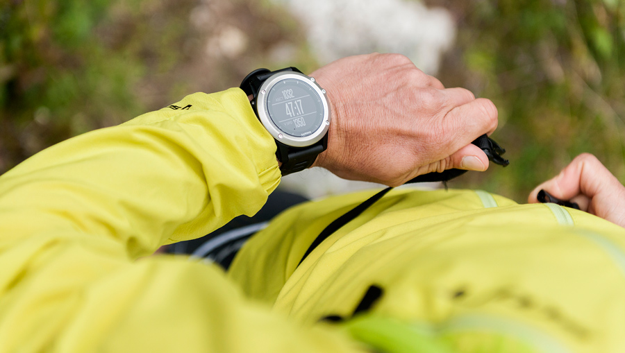 trail runner looking at their fitness watch