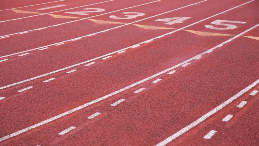 the surface of a running track