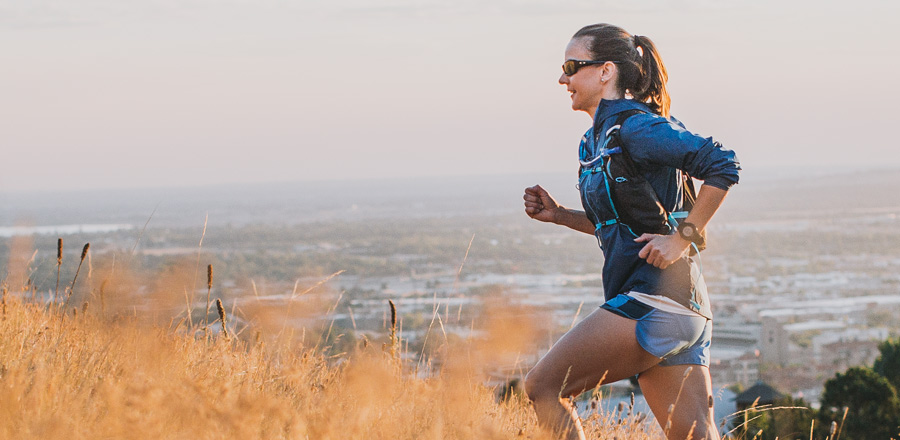 trail runner with a running pack on