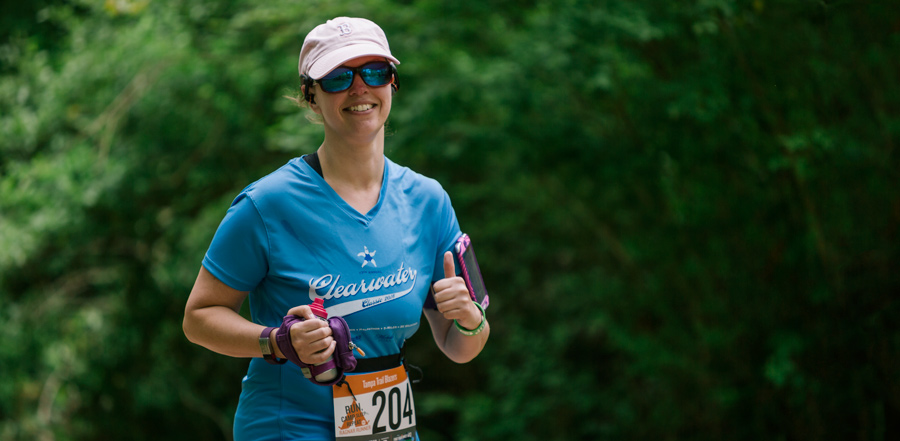 a happy trail running race participant giving the thumbs up