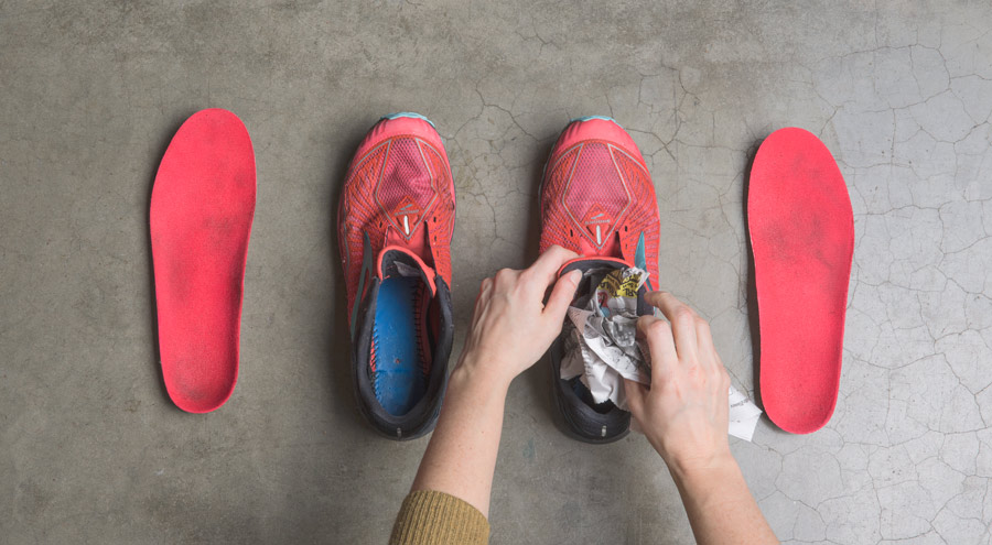 drying running shoes after they've been cleaned, by placing newspaper inside
