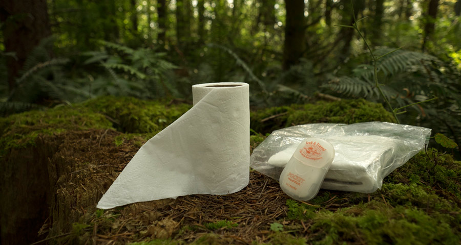 backcountry bathroom toolkit, including toilet paper and hand sanitizer