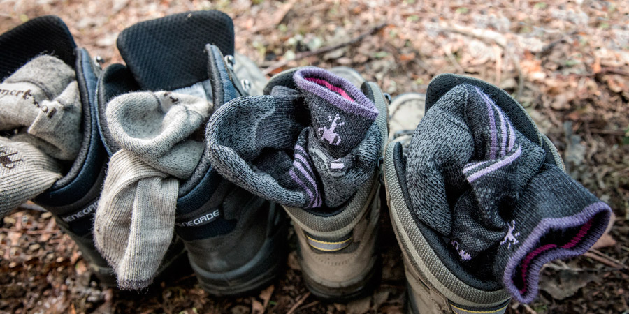 top down view of some hiking socks stuffed into the tops of hiking boots