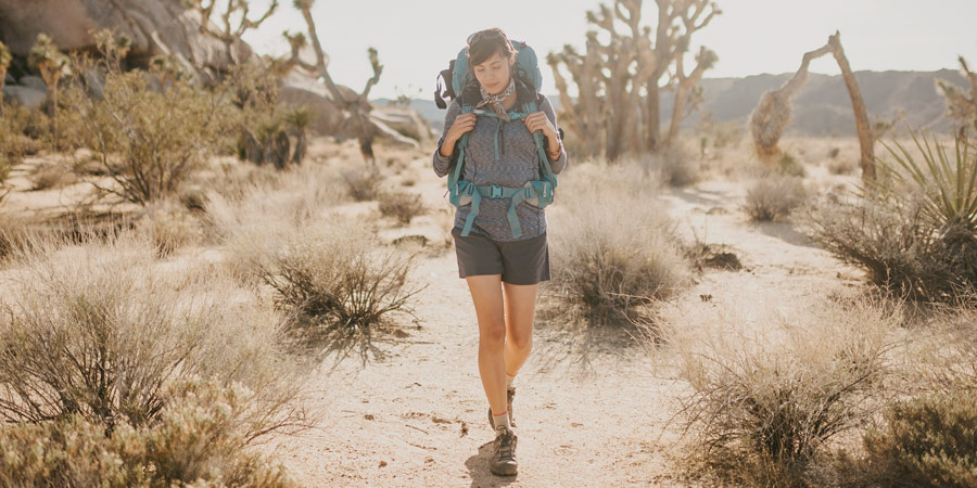 a backpacker hiking in the desert