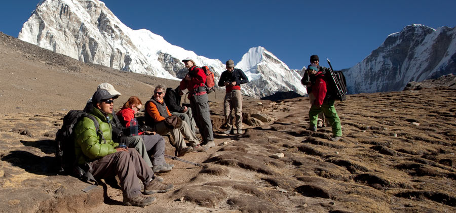 fitnessinf Expert Advice - How to Identify and Treat Altitude Sickness - a group of hikers taking a rest on a high elevation hike