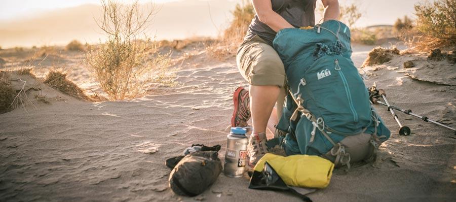 a female backpacker packing her pack