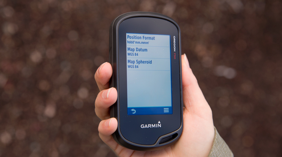 fitnessinf Expert Advice: How to Choose and Use a GPS - Setting Up Your GPS - handheld gps unit in hand, adjusting position format menu