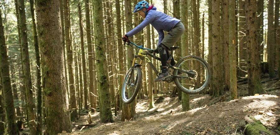 Mountain biker jumping bike on trail
