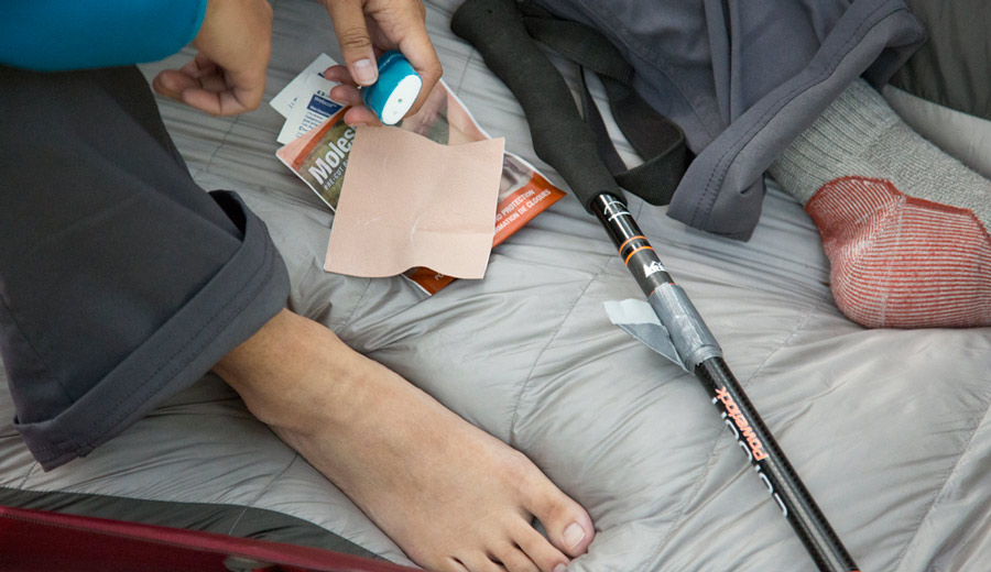 a hiker with supplies for blister prevention