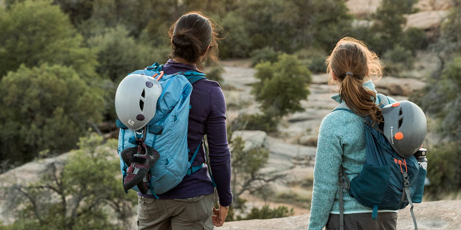 two climbers with climbing gear attached to their climbing daypack