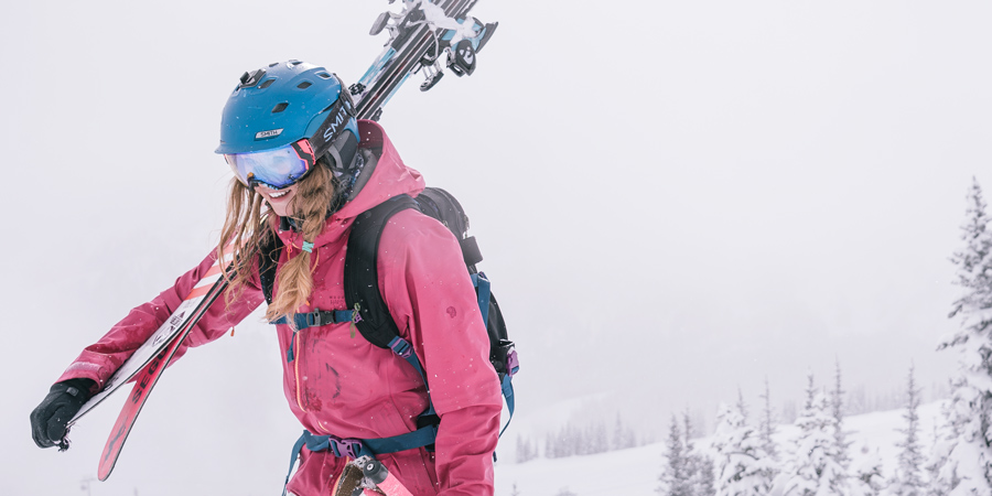a skiier wearing a snowsports backpack