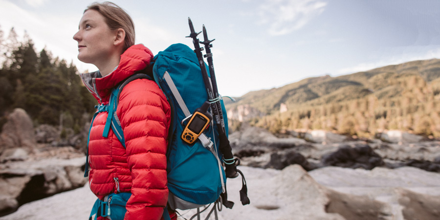a backpacker using a daypack for an ultralight backpacking trip