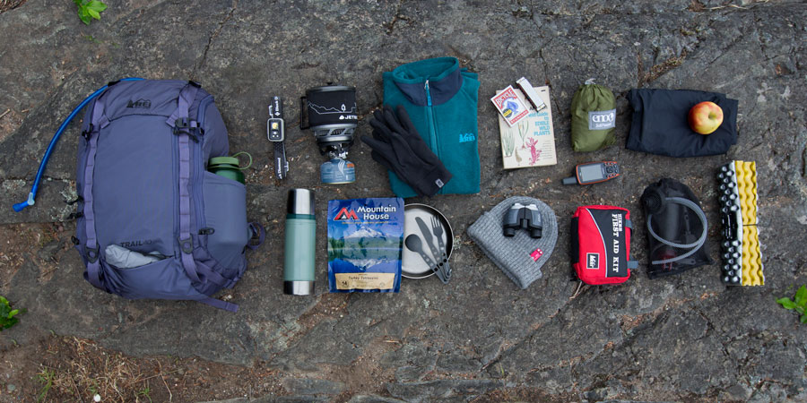 an array of gear that would fit into a daypack with gear capacity of 36-50 liters