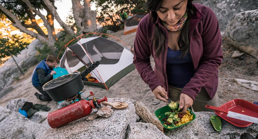 camper preparing a meal at camp