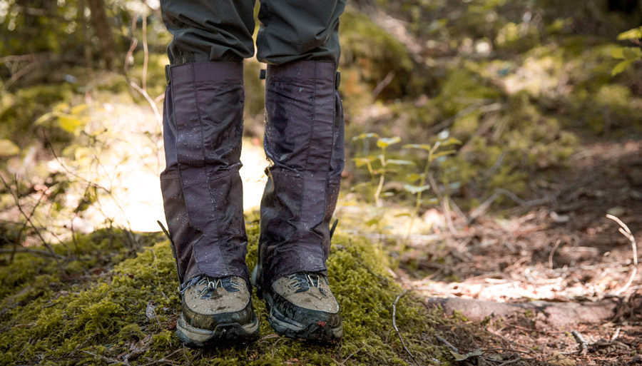 a hiker wearing gaiters in wet conditions