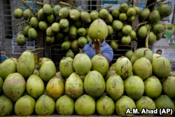 A Bangladeshi street vendor sells coconut on a street in Dhaka, Bangladesh, 2016. (AP Photo/ A.M. Ahad)